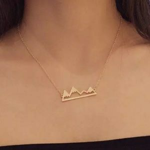 Gold tone Snowy Mountain Necklace